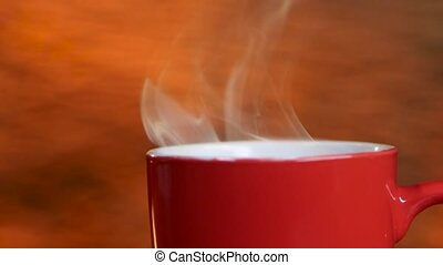 Red refreshing cup of fragrant coffee spreads pleasant...