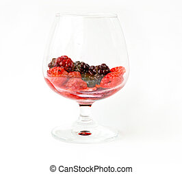 Red refreshing, healthy mixed berries fruit in glass. On white background