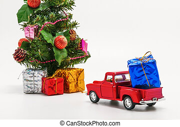 red retro car toy carries a box with a gift for Christmas tree