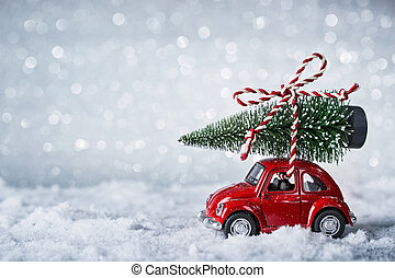 Red retro car with a christmas tree