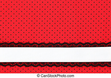 Red retro polka dot textile background with ribbon