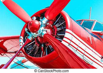 Red retro propeller engine airplane