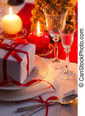 Red ribbon as an accent on Christmas table