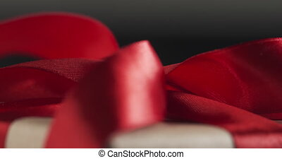red ribbon bow close up focus pull, 4k prores footage