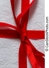 Red ribbon on a Christmas gift
