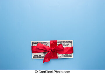 Red Ribbon on Bunch of US dollars