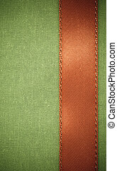 red ribbon on green fabric background with copy space.