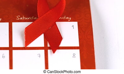 Red ribbon symbol for Aids falling
