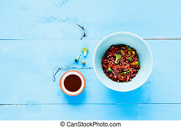 Red rice and broccoli bowl.