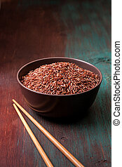 red rice in a ceramic bowl