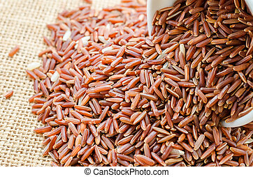 red rice in a white bowl.