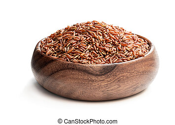 Red rice in wooden bowl isolated on white