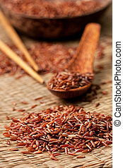 red rice on a straw background