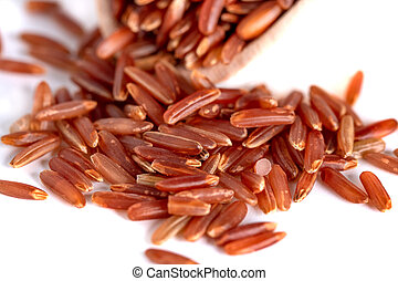 Red rice on wooden spoon isolated on a white background