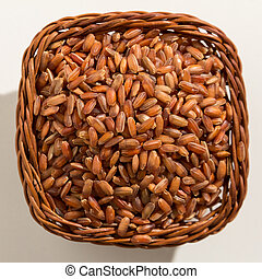 Red Rice seed. Top view of grains in a basket. Close up.