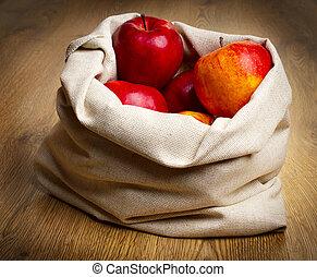 Red ripe apples in sack
