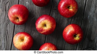 Red ripe apples on wooden table - From above shot of few...