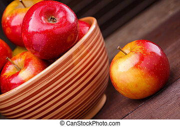 red ripe apples - red apples on wooden background