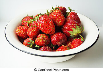 Red ripe berries of the strawberries on light background