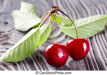 Red ripe cherries with leaves