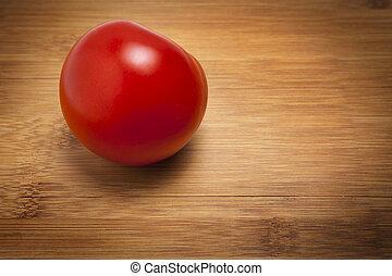 Red Ripe Tomato on Cutting Board