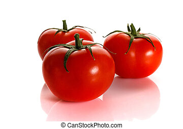 Red ripe tomato with the handle isolated on white background