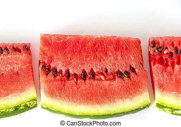 Red ripe watermelon sliced on a white background.