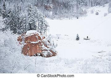 Red rock and river Amata, Latvia.