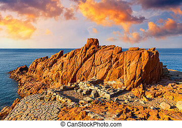 "Red Rocks (called ""Rocce Rosse"") of Arbatax, Sardinia, Italy. Arbatax with the known red porphyry rocks nearby the port at the Capo Bellavista, Sardinia, Italy"