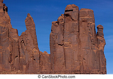 Red rocks like fingers of a hand in Monument Valley, USA - ...