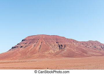 Red, rocky Namib desert landscape near Springbokwasser