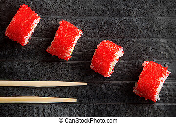 red rolls on a dark plate