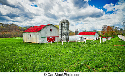 Red Roof Barn with Silo in Early Spring