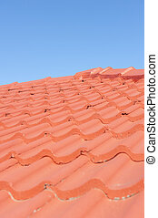 Red roof tiles blue sky background