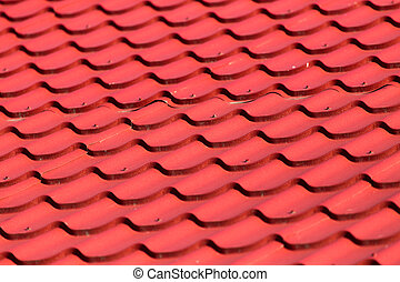red roof tiles on the roof as a background