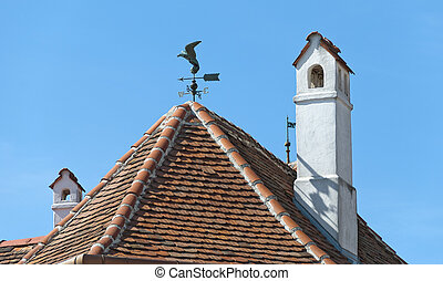 Red roof with chimneys and wind vane - Red tiled roof with...