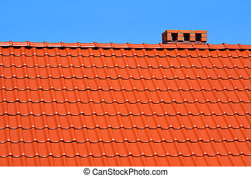 red roofing-tiles with blue sky above