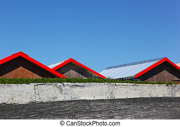 Red Roofs On Blue Sky Background