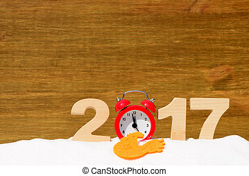 Red rooster, symbol of 2017 on the Chinese calendar. Lollipop in the form of a red rooster on a wooden background