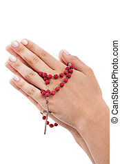 Red rosary - Hands of a believer with a red rosary