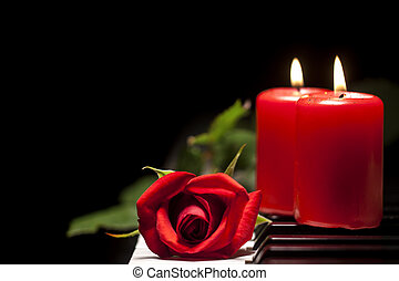 Red Rose and Candle on Piano Keys