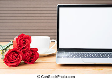 Red rose and coffee cup with laptop mockup on wood