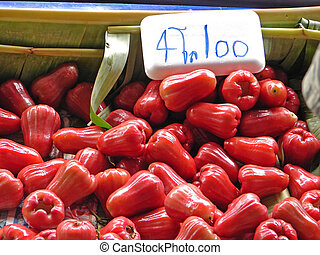 Red rose apple with a price tag in the market