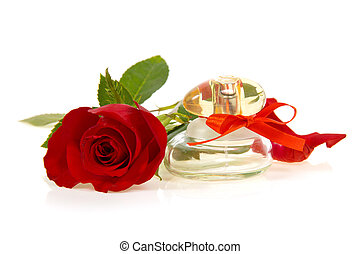 Red rose bud and bottle of perfume - Bud of red rose and...