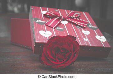 red rose flower with gift box for Valentine's Day, vintage...