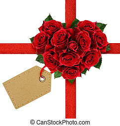 Red rose flowers heart and a ribbon with tag