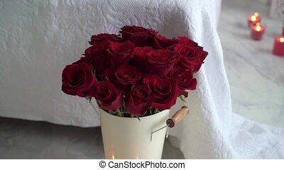 Red rose flowers in bedroom