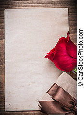 Red rose gift box blank sheet of paper holiday concept