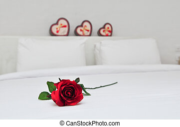 Red rose on a bed