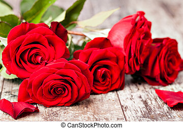 Red rose on a wooden table